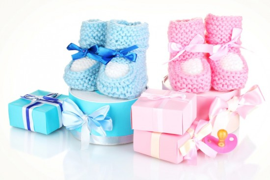 baby boots, pacifier, gifts and blank postcard  isolated